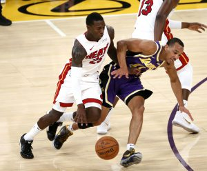 Miami Heat guard Kendrick Nunn and Los Angeles Lakers' guard Avery Bradley fight for a ball.